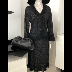 Black skirt suit by Nancy Yang